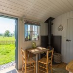 Breakfast seating and view from the door of Shepherd hut