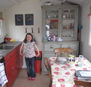 A child in the yurt kitchen